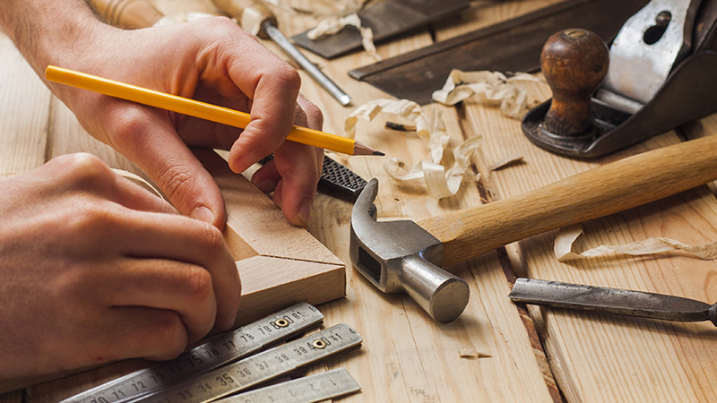 carpenter working,hammer,meter and screw-driver on construction